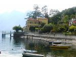 A view south along the lake shore to Taverna Bleu with the 'molo tragetti' (ferry jetty) on the left